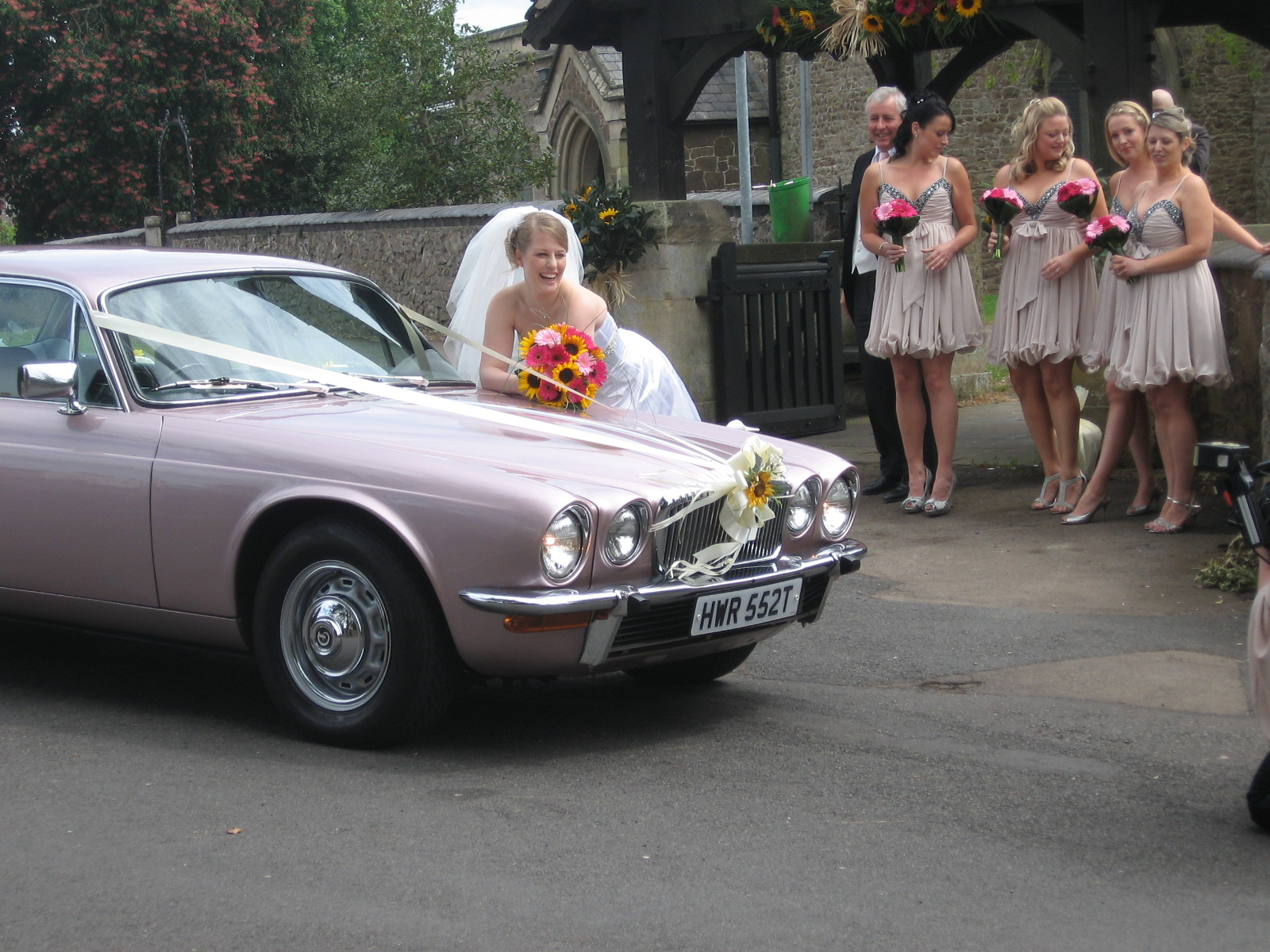 Vickie and Wills Pink Daimler wedding car by pinkmybride.com